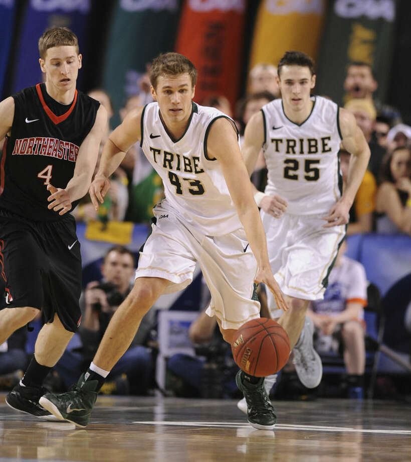 William and Mary's Tom Schalk, center, runs the ball on a turnover by Northeastern in the half of an NCAA basketball game in the CAA Championship basketball tournament Monday, March 9, 2015, in Baltimore. (AP Photo/Gail Burton)