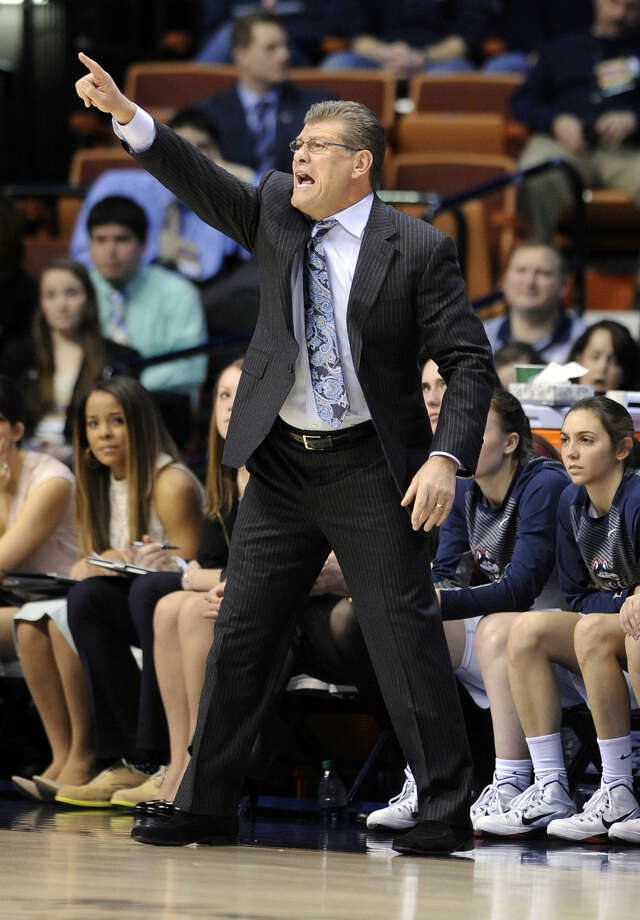 Connecticut head coach Geno Auriemma reacts during the first half of his team's 84-70 victory over USF in an NCAA college basketball game in the finals of the American Athletic Conference tournament in Uncasville, Conn., on Monday, March 9, 2015. (AP Photo/Fred Beckham)
