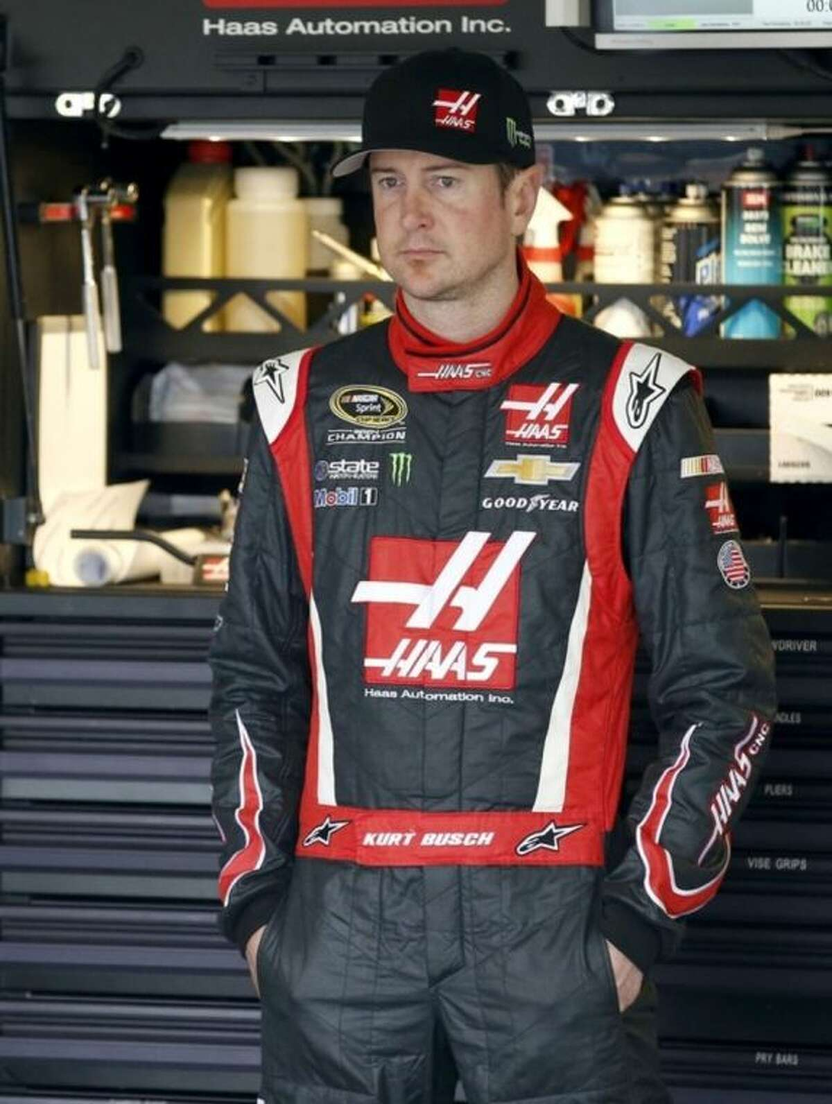 Kurt Busch stands by himself in the garage during NASCAR Sprint Cup auto racing practice Saturday, March 1, 2014, in Avondale, Ariz. (AP Photo/Ross D. Franklin)