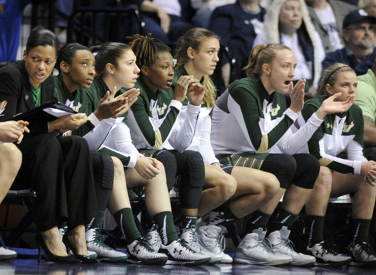 USF players react late in the second half of their 84-70 loss to Connecticut in an NCAA college basketball game in the finals of the American Athletic Conference tournament in Uncasville, Conn., on Monday, March 9, 2015. (AP Photo/Fred Beckham)