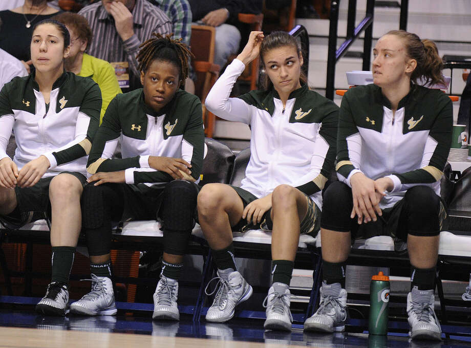 Members of USF react during the first half of an NCAA college basketball game against Connecticut in the finals of the American Athletic Conference tournament in Uncasville, Conn., on Monday, March 9, 2015. (AP Photo/Fred Beckham)