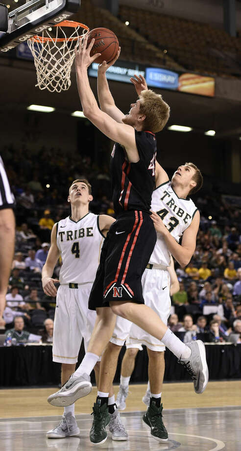 Northeastern's Scott Eatherton, left, shoots as William and Mary's Tom Schalk tries to block in the half of an NCAA college basketball game in the CAA Championship basketball tournament Monday, March 9, 2015, in Baltimore. (AP Photo/Gail Burton)