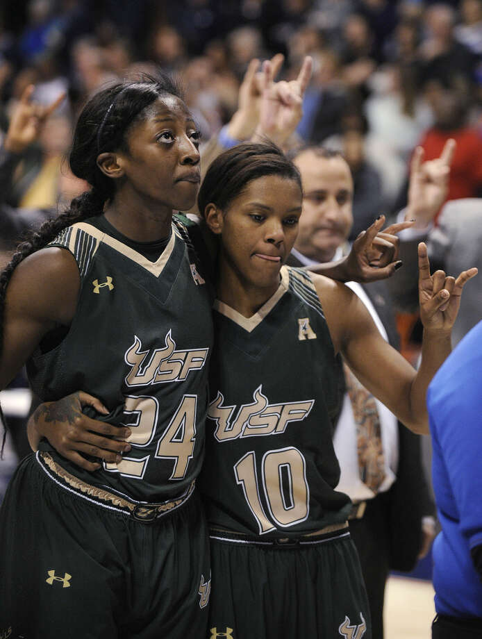 USF's Alisia Jenkins (24) and Courtney Williams (10) react after their 84-70 loss to Connecticut in an NCAA college basketball game in the finals of the American Athletic Conference tournament in Uncasville, Conn., on Monday, March 9, 2015. (AP Photo/Fred Beckham)