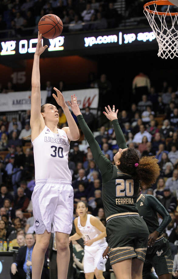 Connecticut's Breanna Stewart (30) shoots over USF's Laura Ferreira (20) during the first half of an NCAA college basketball game in the finals of the American Athletic Conference tournament in Uncasville, Conn., on Monday, March 9, 2015. Stewart scored 22 points and had 12 rebounds in her team's 84-70 victory. (AP Photo/Fred Beckham)