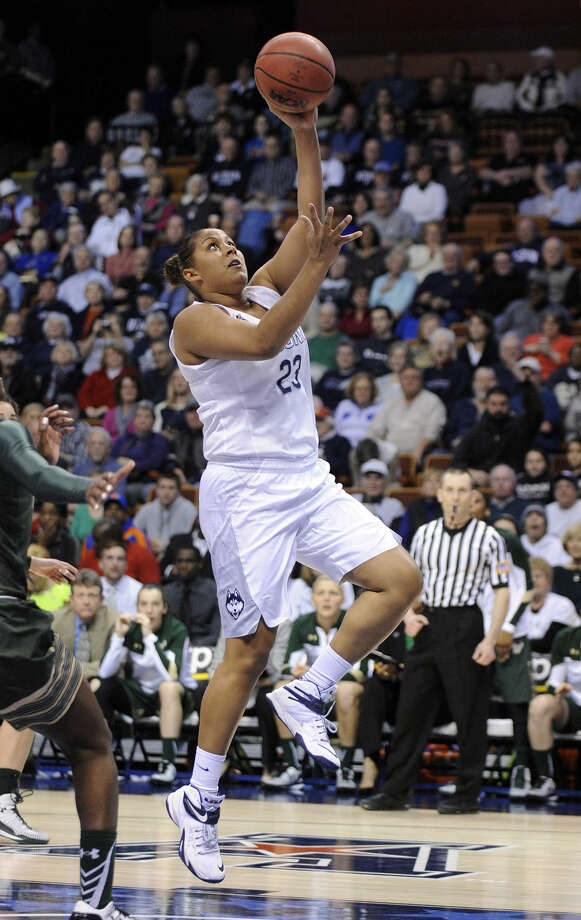 Connecticut's Kaleena Mosqueda-Lewis (23) scores during the first half of an NCAA college basketball game against USF in the finals of the American Athletic Conference tournament in Uncasville, Conn., on Monday, March 9, 2015. Mosqueda-Lewis scored a game-high 23 points in her team's 84-70 victory. (23)(AP Photo/Fred Beckham)