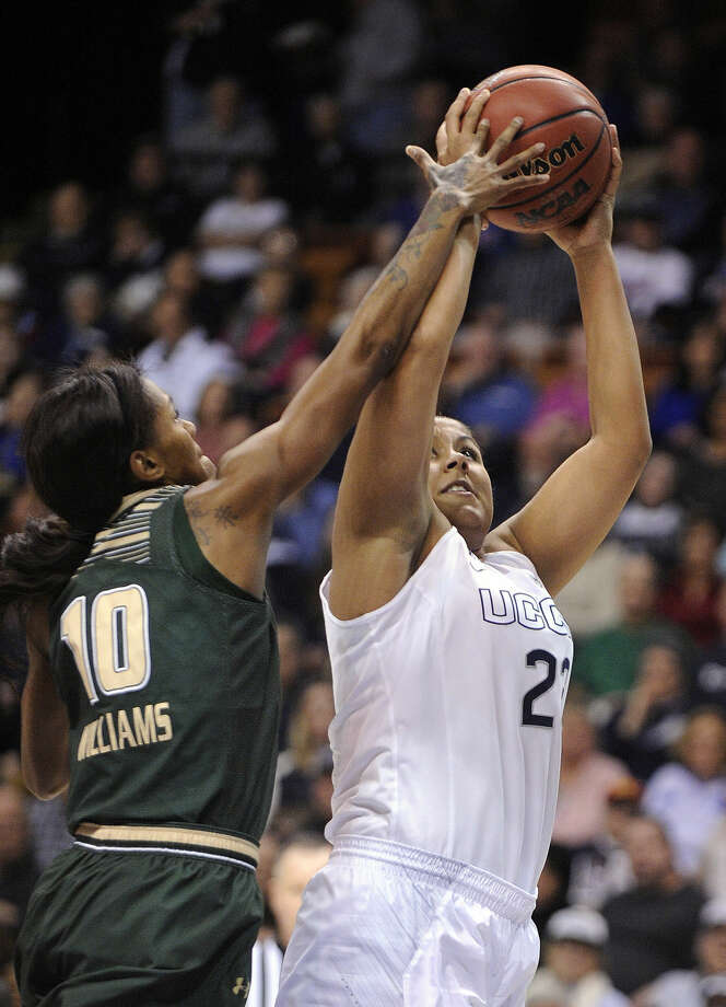 Connecticut's Kaleena Mosqueda-Lewis (23) drives past USF's Courtney Williams (10) during the first half of an NCAA college basketball game in the finals of the American Athletic Conference tournament in Uncasville, Conn., on Monday, March 9, 2015. (AP Photo/Fred Beckham)