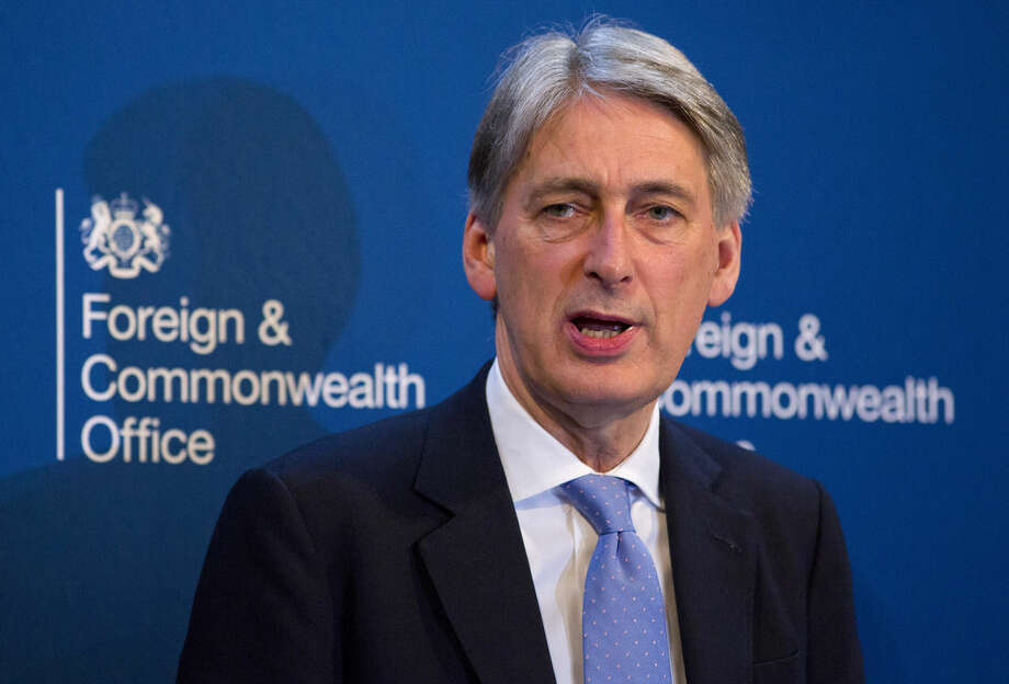 "British Foreign Minister Philip Hammond addresses the media in London, Tuesday March 10, 2015, commenting on the situation in Ukraine and Britain's Intelligence and Security services. Hammond strongly defended Britain's intelligence services, countering recent allegations by Muslim advocacy organization CAGE, saying people who act as ""apologists"" for terrorists are partly to blame. (AP Photo/Justin Tallis, pool)"