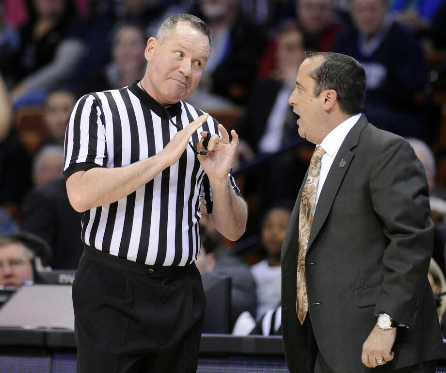 USF head coach Jose Fernandez, right, speaks with an official during the first half of an NCAA college basketball game in the finals of the American Athletic Conference tournament in Uncasville, Conn., on Monday, March 9, 2015. (AP Photo/Fred Beckham)