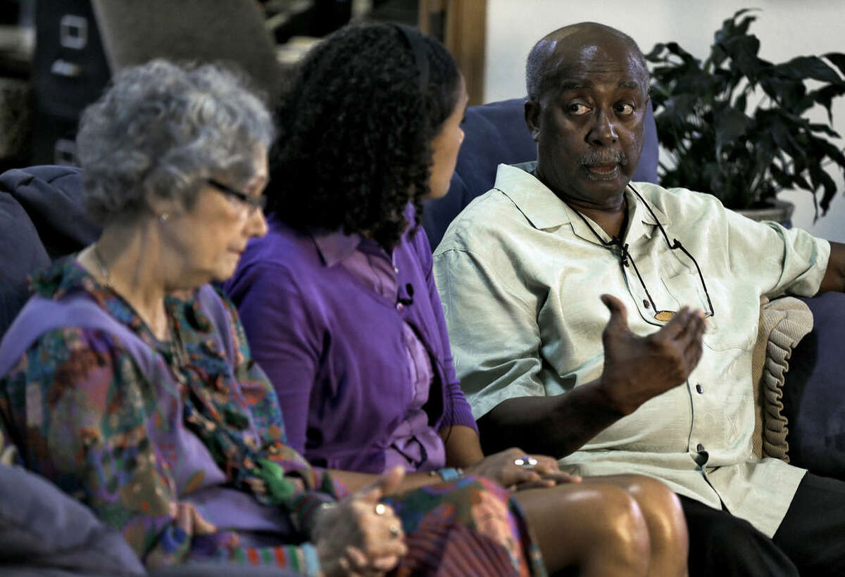 In this March 6, 2015 photo, William Thompson, right, speaks as his wife, Judith, left, and their daughter Jennifer look on during an interview at their home in Spring Hill, Fla. When William and Judith met comedian Bill Cosby in the late 1980s to discuss their teen daughter's modeling and acting career, they felt immediately at ease. However, more than 20 women have stepped forward in recent months to level various accusations against Cosby, ranging from unwanted advances to sexual assault and rape. (AP Photo/Chris O'Meara)