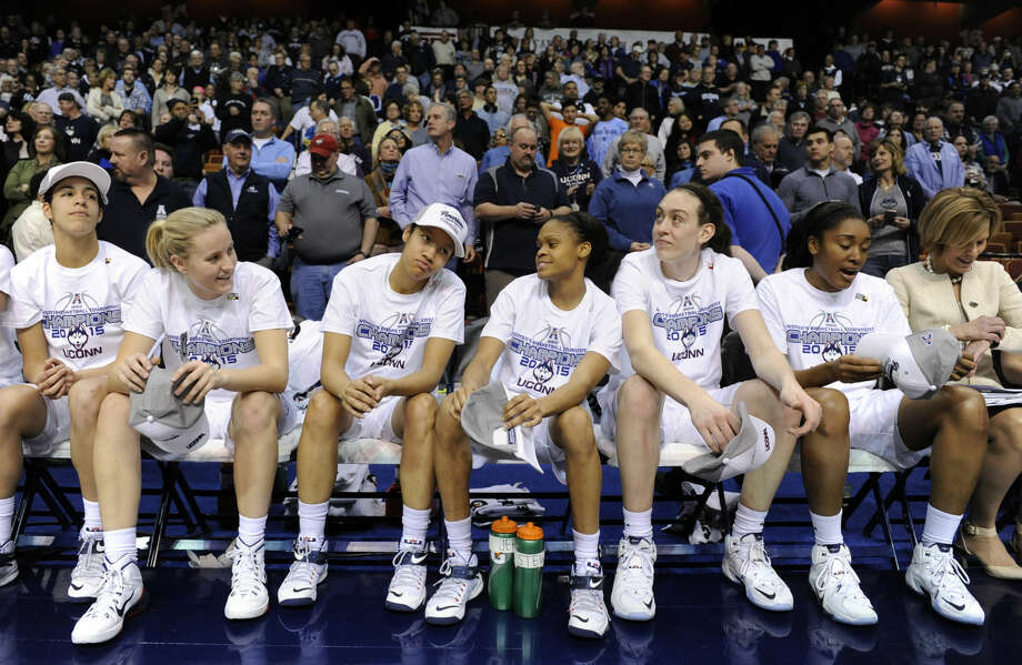 Members of Connecticut's women's basketball team react after their 84-70 victory over USF in an NCAA college basketball game in the finals of the American Athletic Conference tournament in Uncasville, Conn., on Monday, March 9, 2015. (AP Photo/Fred Beckham)