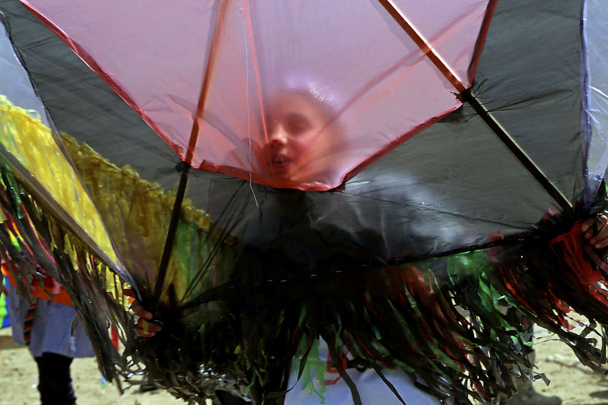 A Palestinian student prepares to fly her kite during a commemoration to mark the fourth anniversary of Japan's Tsunami organized by the United Nations Relief and Works Agency, in Khan Younis, southern Gaza Strip, Monday, March 9, 2015. (AP Photo/Adel Hana))