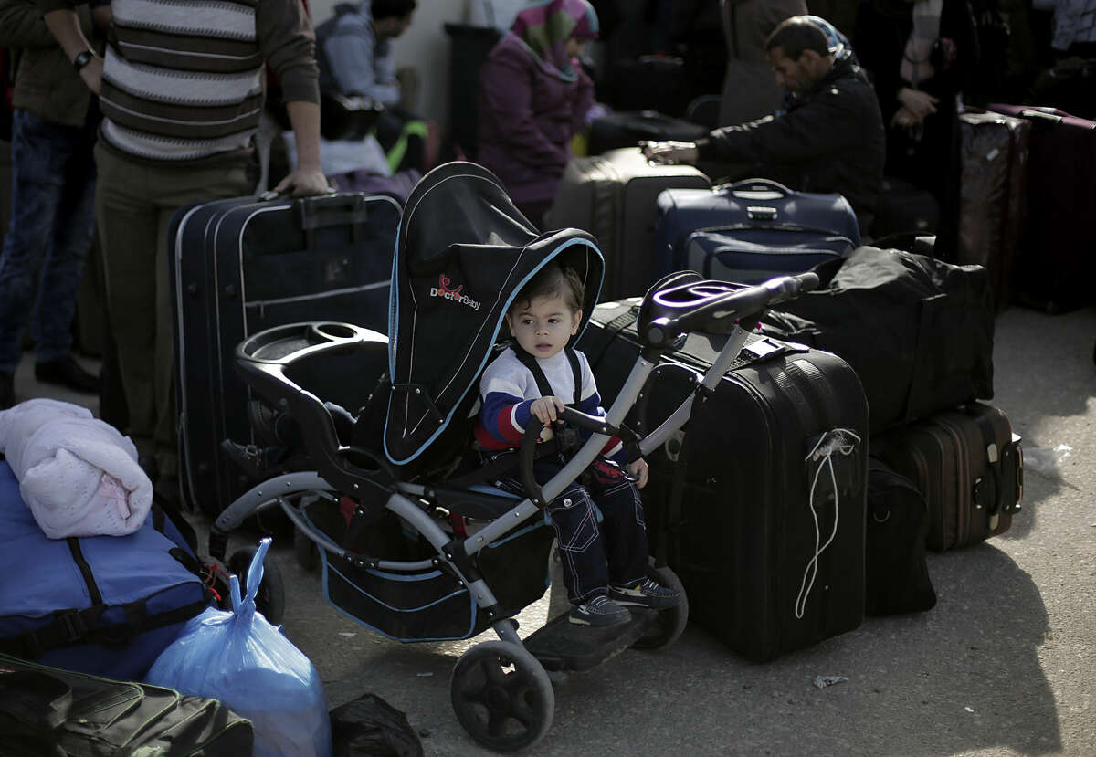 Palestinians wait with their luggage to cross the border into Egypt, at the Rafah crossing in the southern Gaza Strip, Monday, March 9, 2015. Egypt has temporarily opened a crossing with the Gaza Strip for the first time in nearly two months. The Rafah crossing was opened Monday for two days for students, patients seeking medical care and dual nationals. It was the first time it was opened since an Egyptian court declared the territory's rulers, Hamas, a terrorist organization. (AP Photo/Khalil Hamra)