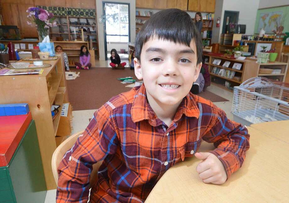 Kiran Rao in his second-grade classroom at the Wilton Montessori School, helped put a Mandarin language program in place for students.