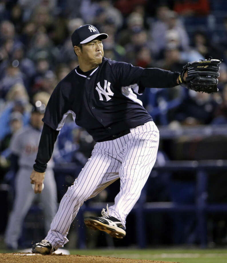 New York Yankees starting pitcher Hiroki Kuroda delivers in the second inning of a spring training baseball game against the Detroit Tigers in Tampa, Fla., Friday, March 7, 2014. (AP Photo/Kathy Willens)