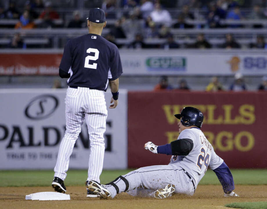Detroit Tigers first baseman Miguel Cabrera (24) slides safely into second on a first-inning double as New York Yankees shortstop Derek Jeter (2) waits for the throw from the outfield in a spring training baseball game in Tampa, Fla., Friday, March 7, 2014. (AP Photo/Kathy Willens)