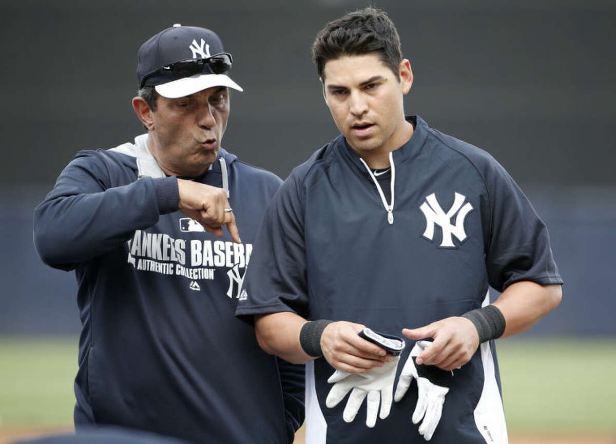 New York Yankees spring training guest instructor Lee Mazzilli, left, gives advice to the Yankees Jacoby Ellsbury after Ellsbury took batting practice before a spring training baseball game against the Detroit Tigers in Tampa, Fla., Friday, March 7, 2014. (AP Photo/Kathy Willens)