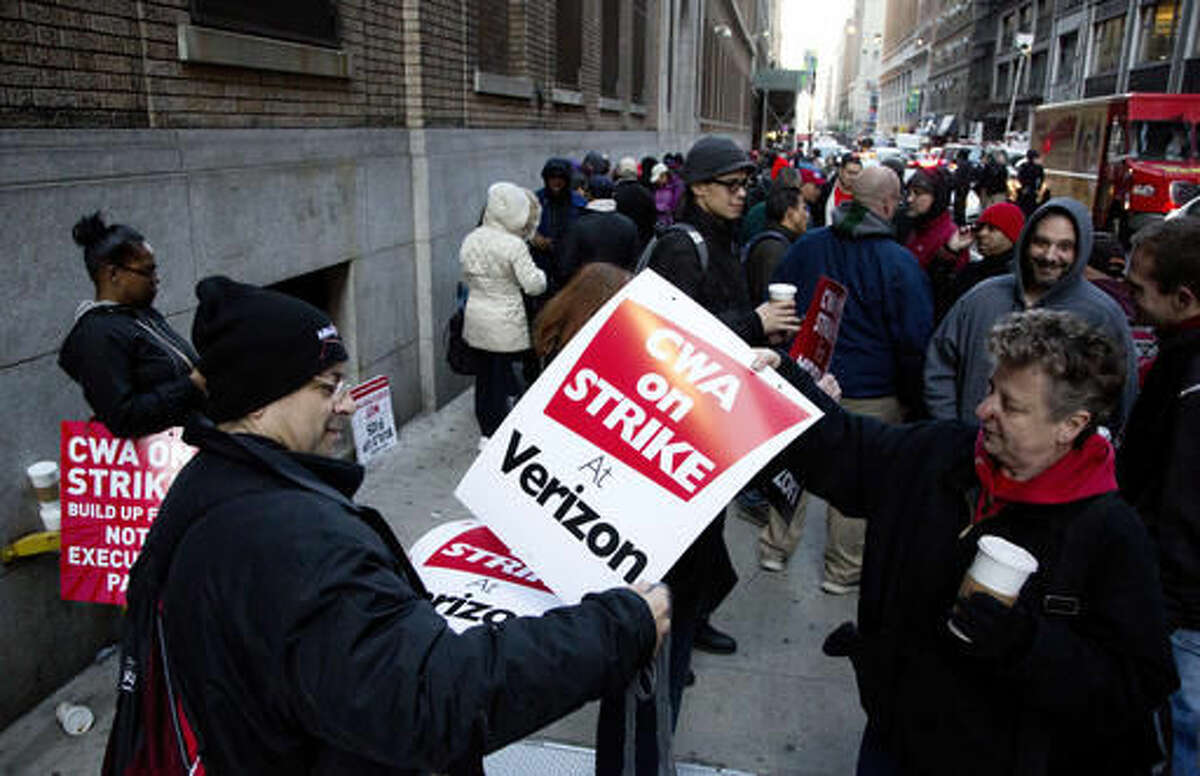 Verizon workers picket in front of a company facility, Wednesday, April 13, 2016, in New York. About 39,000 Verizon landline and cable workers on the East Coast walked off the job Wednesday morning after little progress in negotiations since their contract expired nearly eight months ago. (AP Photo/Mark Lennihan)