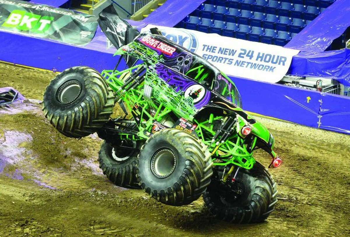 Hour Photo / Alex von Kleydorff GraveDigger driven by Carl Von Horn lands on two wheels after crushing some cars during competition at Monster Jam on Friday night at Webster Bank arena