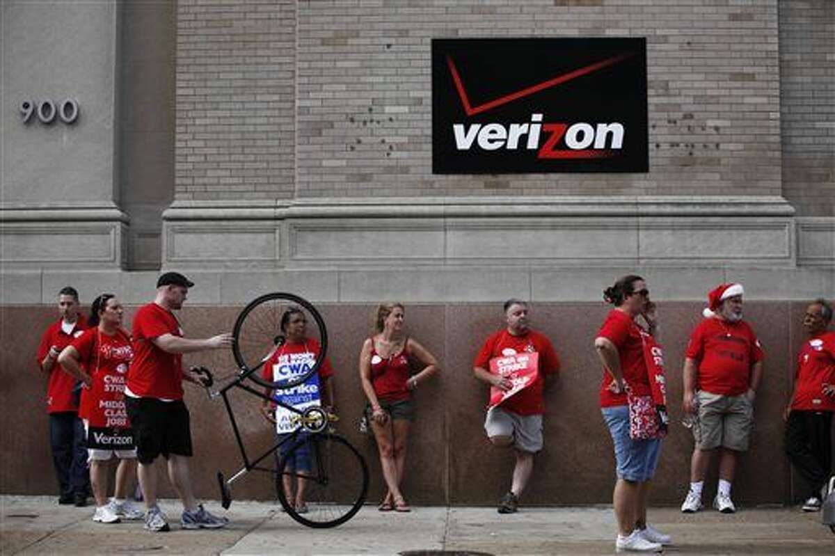 FILE - In this Aug. 8, 2011 file photo, Verizon workers picket outside one of the company's central offices in Philadelphia. Verizon landline and cable workers in nine eastern states and Washington, D.C., are expected to walk off the job Wednesday, April 13, 2016, after working without a contract since August. (AP Photo/Matt Rourke, File)