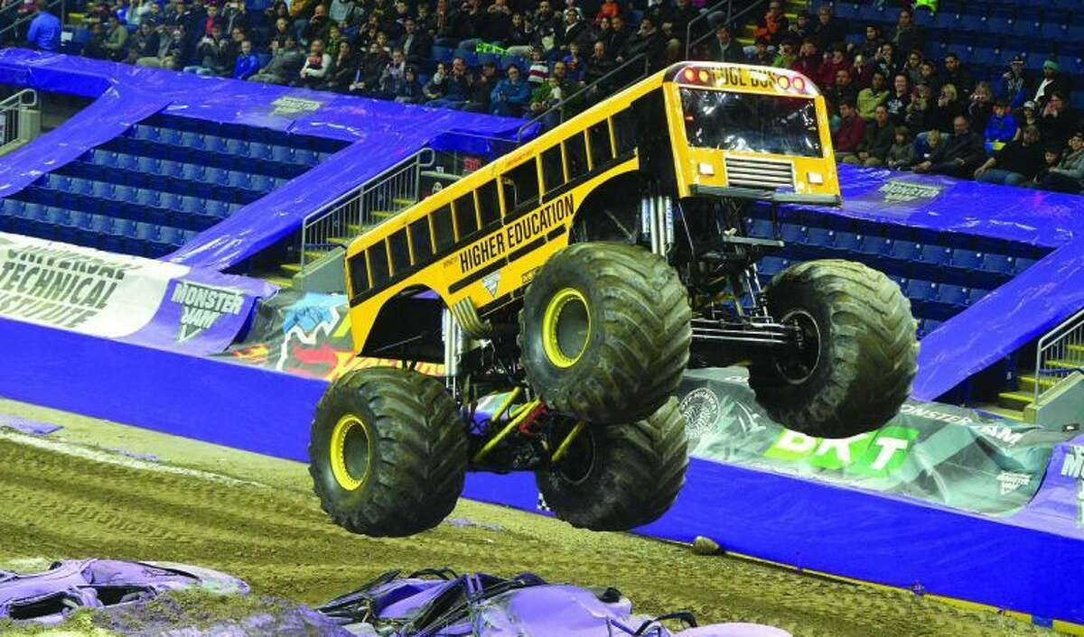 Hour Photo / Alex von Kleydorff Higher Education, driven by Jim Tracy competes in the Wheelie contest during Monster Jam at Webster Bank Arena on Friday night