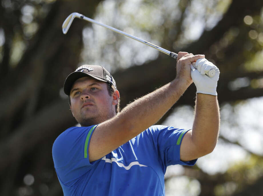 Patrick Reed hits from the fifth tee during the third round of the Cadillac Championship golf tournament on Saturday, March 8, 2014, in Doral, Fla. (AP Photo/Lynne Sladky)