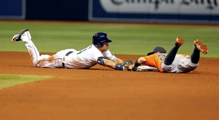 June 10: Rays 4, Astros 3ST. PETERSBURG, FL - JUNE 10: Hank Conger #24 of the Tampa Bay Rays dives back in to second base with a double ahead of a tag by Jose Altuve #27 of the Houston Astros during the fourth inning of a game at Tropicana Field on June 10, 2016 in St. Petersburg, Florida. Photo: Mike Carlson, Getty Images / 2016 Getty Images