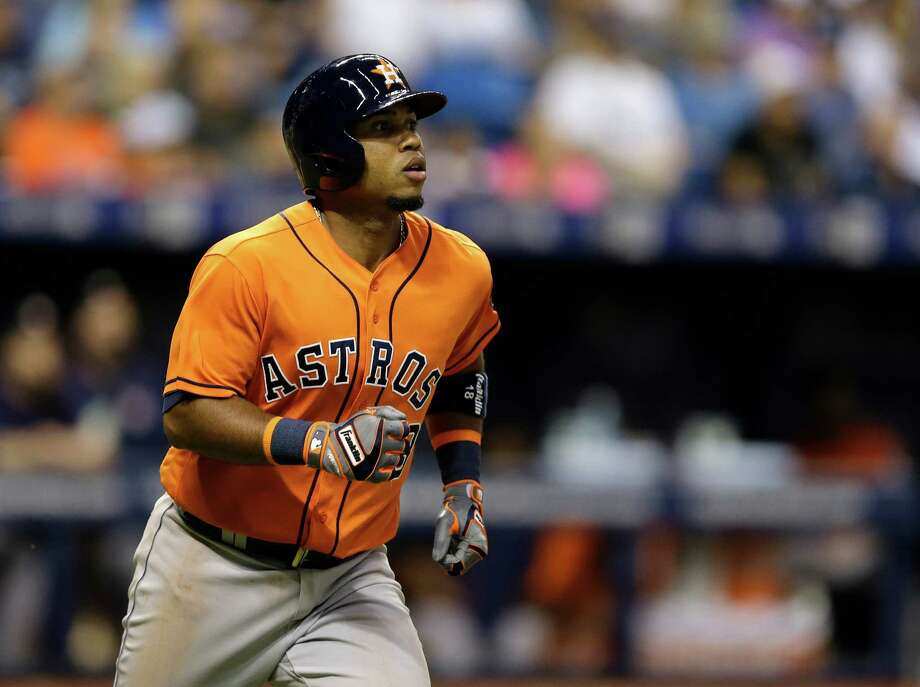 Houston Astros' Luis Valbuena watches his double off Tampa Bay Rays starting pitcher Matt Andriese during the sixth inning of a baseball game Friday, June 10, 2016, in St. Petersburg, Fla.  (AP Photo/Chris O'Meara) Photo: Chris O'Meara, Associated Press / AP