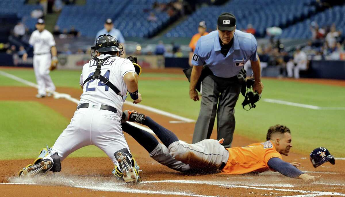 June 10: Rays 4, Astros 3 Tampa Bay Rays catcher Hank Conger (24) tags out Houston Astros' George Springer at home plate after Springer tried to score from second on a single by Jose Altuve during the first inning of a baseball game Friday, June 10, 2016, in St. Petersburg, Fla. (AP Photo/Chris O'Meara)