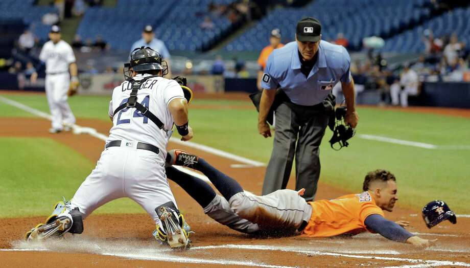 June 10: Rays 4, Astros 3Tampa Bay Rays catcher Hank Conger (24) tags out Houston Astros' George Springer at home plate after Springer tried to score from second on a single by Jose Altuve during the first inning of a baseball game Friday, June 10, 2016, in St. Petersburg, Fla. (AP Photo/Chris O'Meara) Photo: Chris O'Meara, Associated Press / Copyright 2016 The Associated Press. All rights reserved. This material may not be published, broadcast, rewritten or redistribu