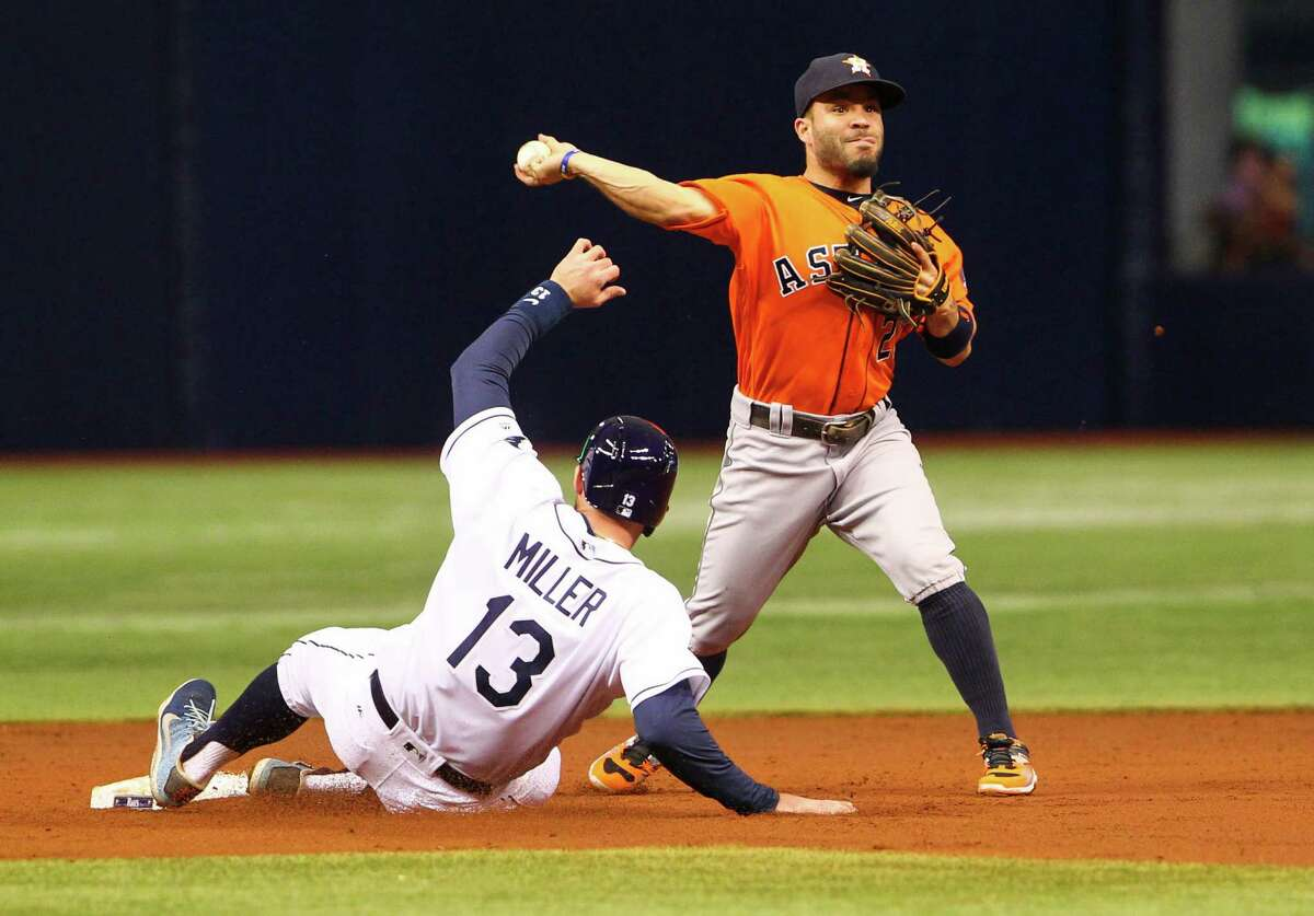 Houston Astros second baseman Jose Altuve forces out the Tampa Bay Rays' Brad Miller (13) at second base in the first inning at Tropicana Field in St. Petersburg, Fla., on Friday, June 10, 2016.