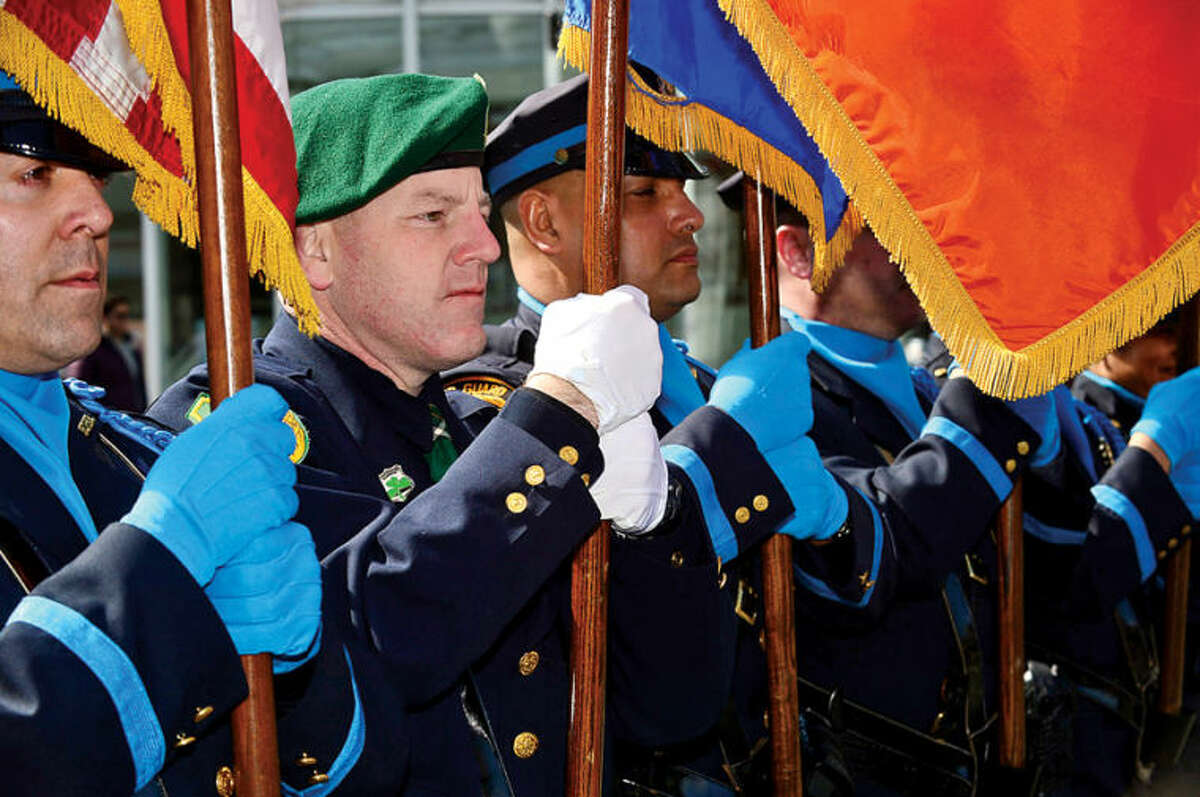 Hour photo / Erik Trautmann The Stamford Police Department Color Guard participates in The Stamford St. Patrick's Day Parade as it follows last year's parade route proceeding North on Atlantic Street and continuing onto Bedford Street Saturday.