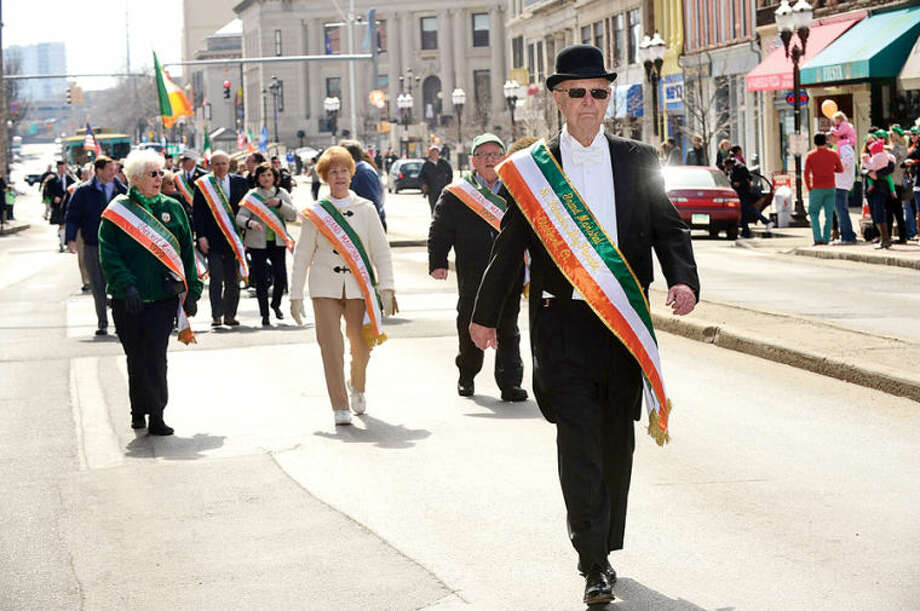 Hour photo / Erik Trautmann Joseph J. Tooher, Jr., serves as Grand Marshal in the The Stamford St. Patrick's Day Parade as it follows last year's parade route proceeding North on Atlantic Street and continuing onto Bedford Street Saturday.