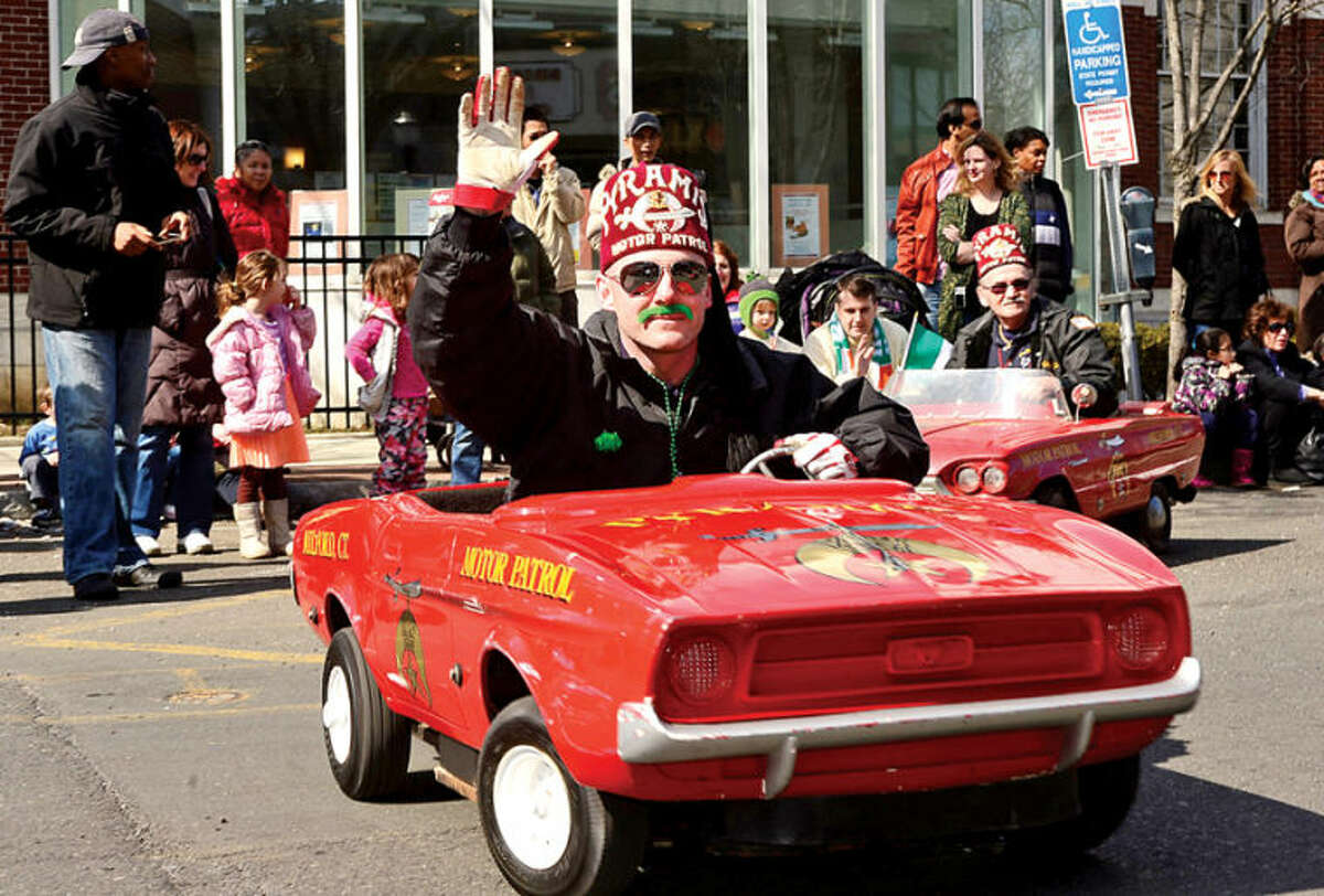 Hour photo / Erik Trautmann The Milford Pyramid Shriners participate in the The Stamford St. Patrick's Day Parade as it follows last year's parade route proceeding North on Atlantic Street and continuing onto Bedford Street Saturday.
