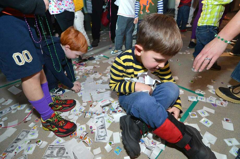 Hour Photo/Alex von Kleydorff 5 yr old Gunther Scheidt grabs all he can thats fallen from the Piñata to the floor during the 15 year anniversary at Stepping Stones Museum for Children