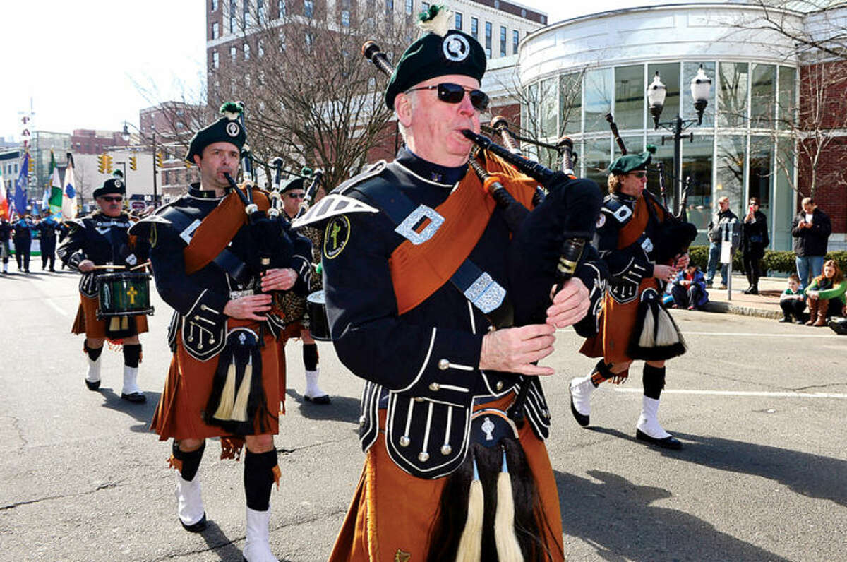 Hour photo / Erik Trautmann The Greenwich Pipe Band participates in the The Stamford St. Patrick's Day Parade as it follows last year's parade route proceeding North on Atlantic Street and continuing onto Bedford Street Saturday.