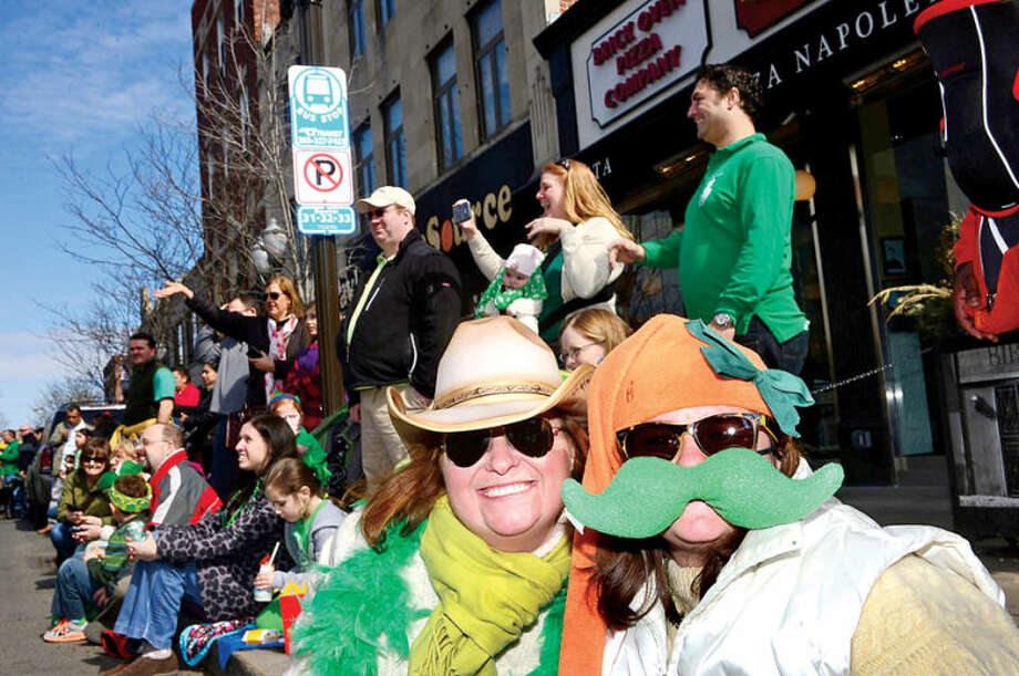Hour photo / Erik Trautmann Area residents including Dee Dee and Francesca Rubino line the streets for The Stamford St. Patrick's Day Parade as it follows last year's parade route proceeding North on Atlantic Street and continuing onto Bedford Street Saturday.