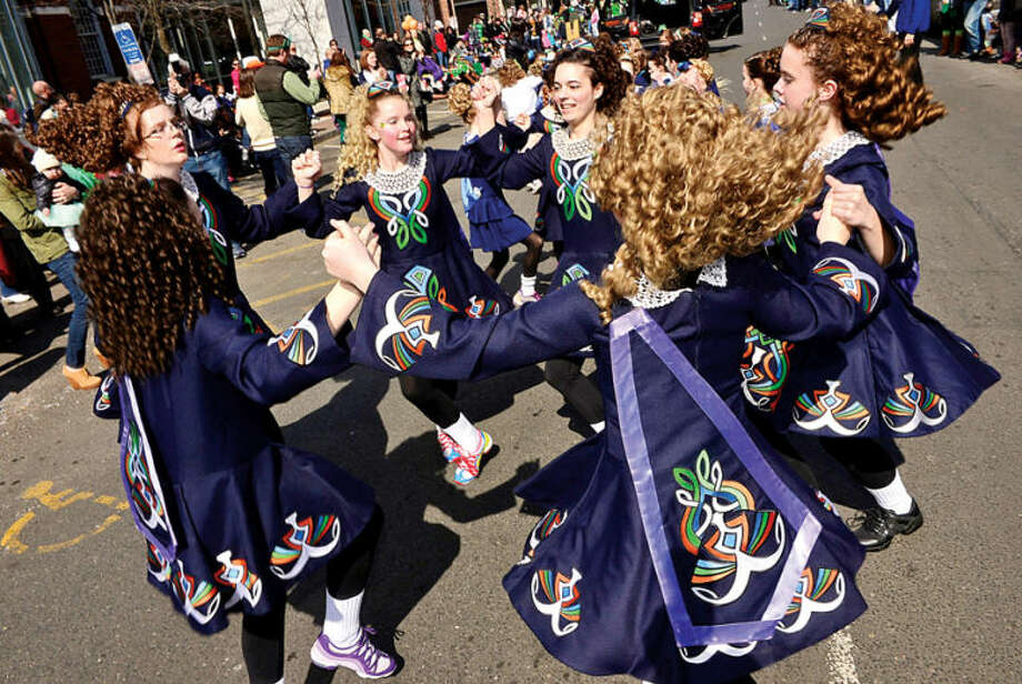 Hour photo / Erik Trautmann Dancers with Anam Cara Irish Dance School participate in the The Stamford St. Patrick's Day Parade as it follows last year's parade route proceeding North on Atlantic Street and continuing onto Bedford Street Saturday.