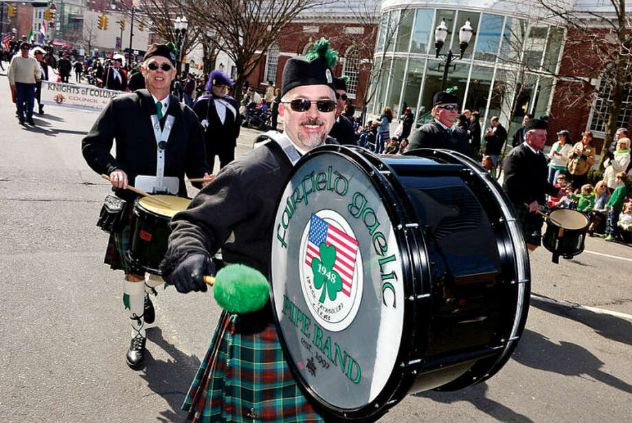 Hour photo / Erik Trautmann Norwalk resident Mike McGovern of the Fairfield Gaelic Pipe Band participates in the The Stamford St. Patrick's Day Parade as it follows last year's parade route proceeding North on Atlantic Street and continuing onto Bedford Street Saturday.
