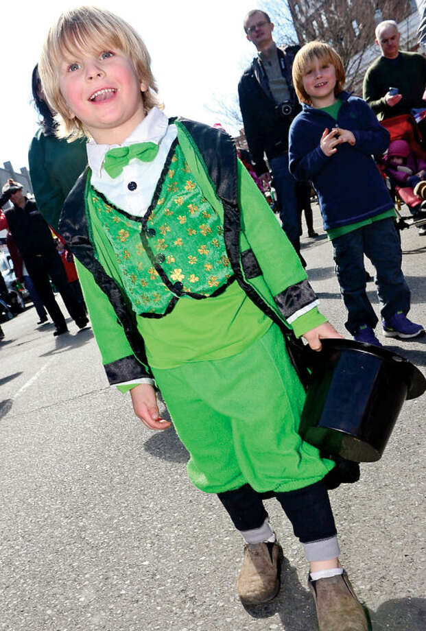 Hour photo / Erik Trautmann Wilson Walker participates in the The Stamford St. Patrick's Day Parade as it follows last year's parade route proceeding North on Atlantic Street and continuing onto Bedford Street Saturday.