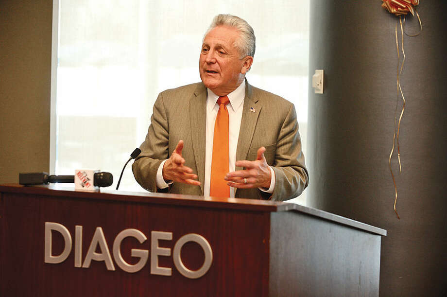 Hour photo / Erik Trautmann Mayor Harry Rilling speaks during the graduation luncheon for DIAGEO's Learning Skills for Life program Wednesday which provides eligible adults with complimentary hospitality and career training.