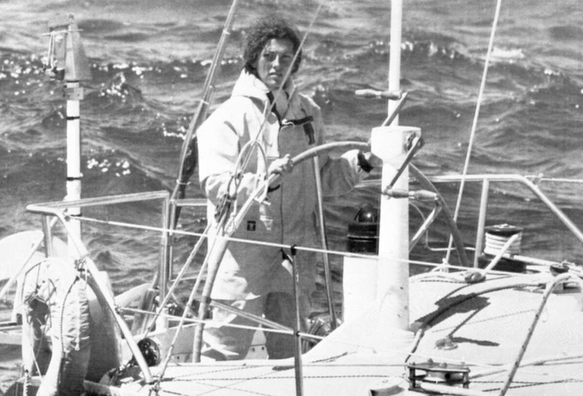 FILE - In this May 26, 1979 file photo, Florence Arthaud of France steers her 15 meter monohull called Biotherm off the Brittany coast. Two helicopters carrying French sports stars filming a popular European reality show crashed Monday March 9, 2015 in a remote part of Argentina, killing10 people, including two Olympic medal winners and sailing champion Florence Arthaud, authorities said. (AP Photo, File)