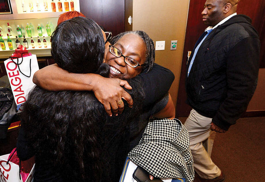 Hour photo / Erik Trautmann Graduates Martha Davis and Nakitta Fuller congratulate each other following the graduation event for DIAGEO's Learning Skills for Life program Wednesday which provides eligible adults with complimentary hospitality and career training.
