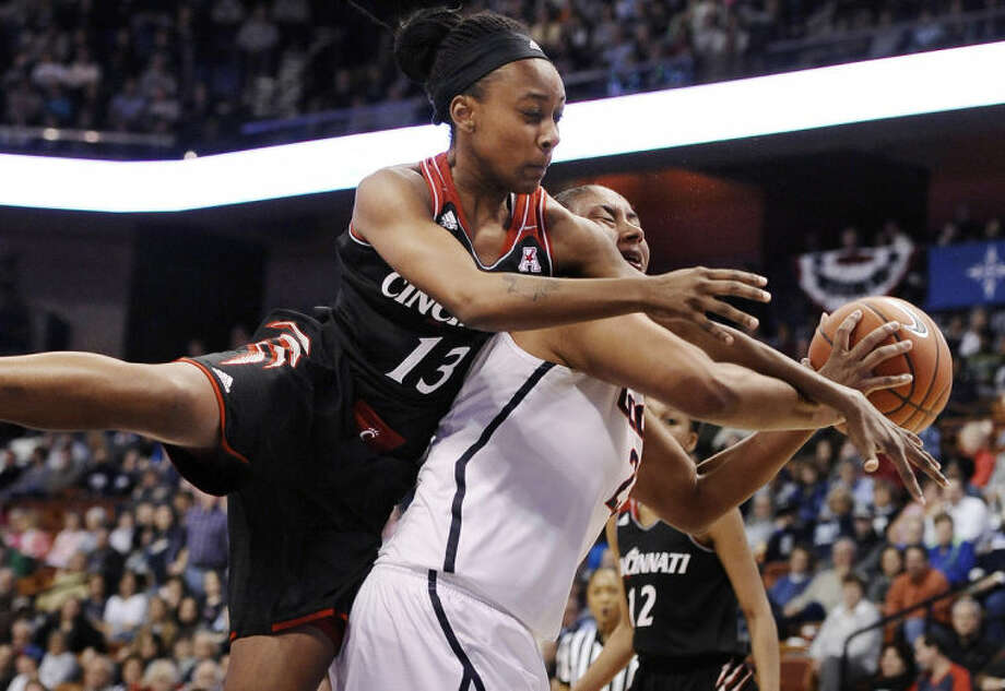 Cincinnati's Brandey Tarver, left, fouls Connecticut's Kaleena Mosqueda-Lewis, right, during the first half of an NCAA college basketball game in the quarterfinals of the American Athletic Conference women's basketball tournament, Saturday, March 8, 2014, in Uncasville, Conn. (AP Photo/Jessica Hill)
