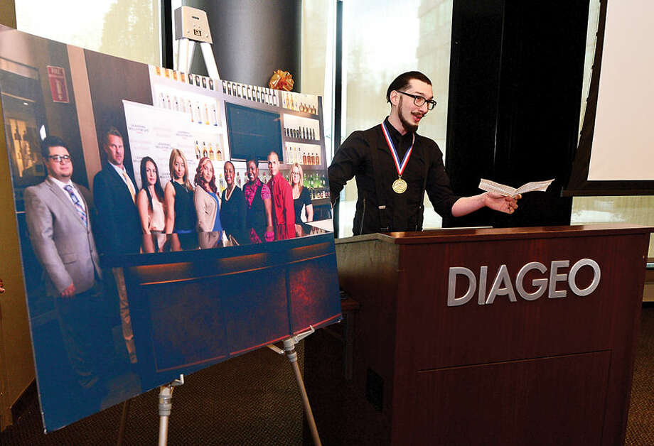Hour photo / Erik Trautmann Learning Skills for Life graduate Ryan Loizzo speaks during the graduation luncheon for the DIAGEO's Learning Skills for Life program Wednesday which provides eligible adults with complimentary hospitality and career training.