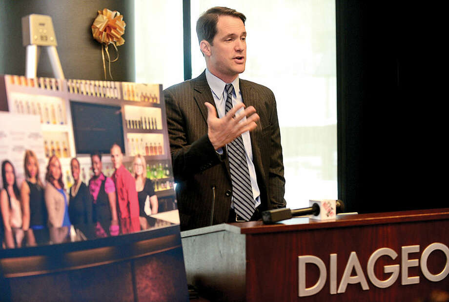Hour photo / Erik Trautmann US congressman Jim Himes speaks during the graduation luncheon for DIAGEO's Learning Skills for Life program Wednesday which provides eligible adults with complimentary hospitality and career training.
