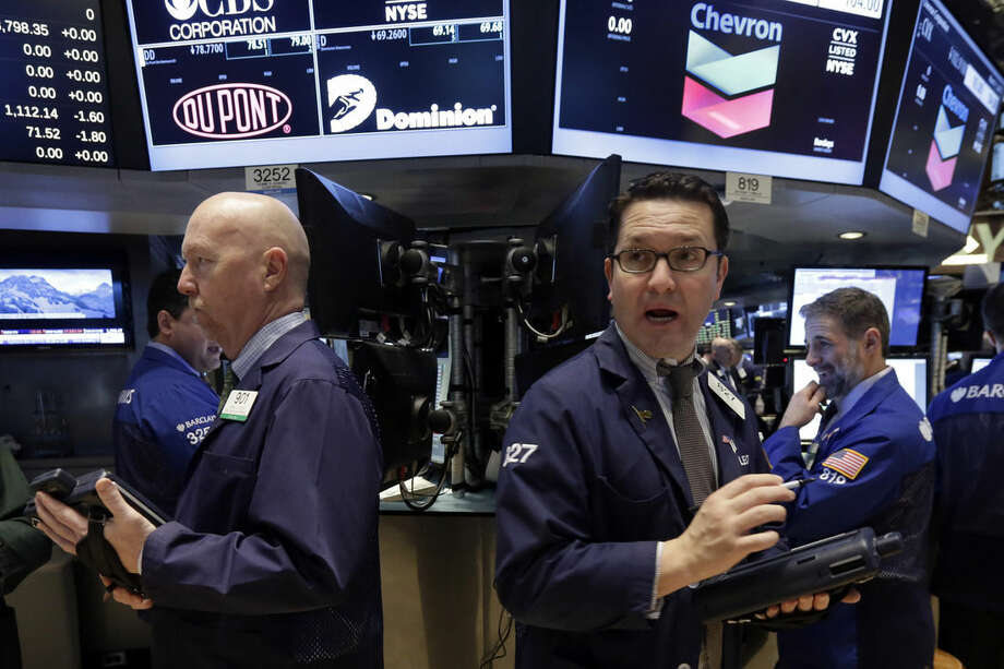Traders work on the floor of the New York Stock Exchange, Wednesday, March 11, 2015. U.S. stock indexes are opening slightly higher, a day after a big sell-off prompted by worries about higher U.S. interest rates. (AP Photo/Richard Drew)