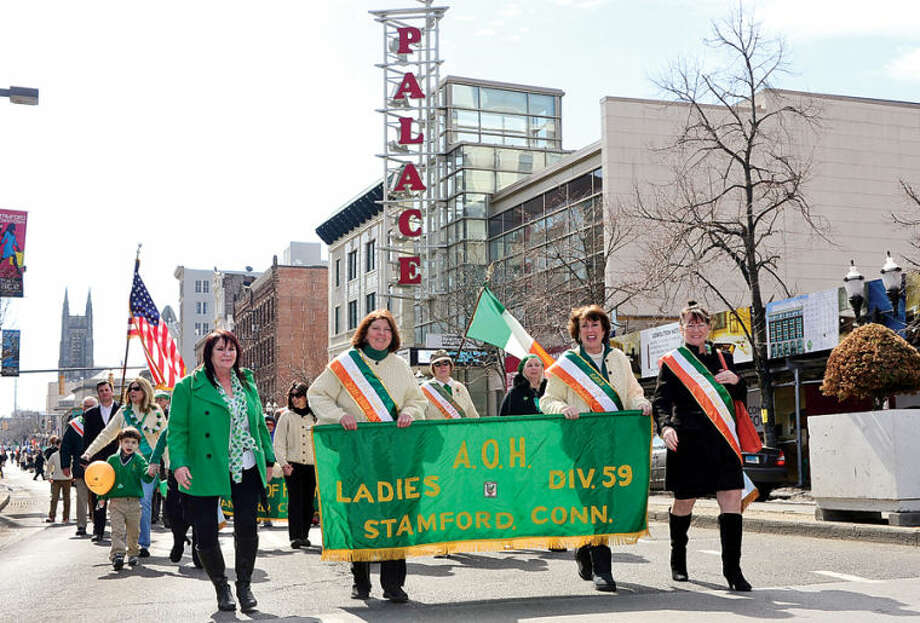 Hour photo / Erik Trautmann Ancient Order of Hibernians Ladies Division 59 participate in The Stamford St. Patrick's Day Parade as it follows last year's parade route proceeding North on Atlantic Street and continuing onto Bedford Street Saturday.