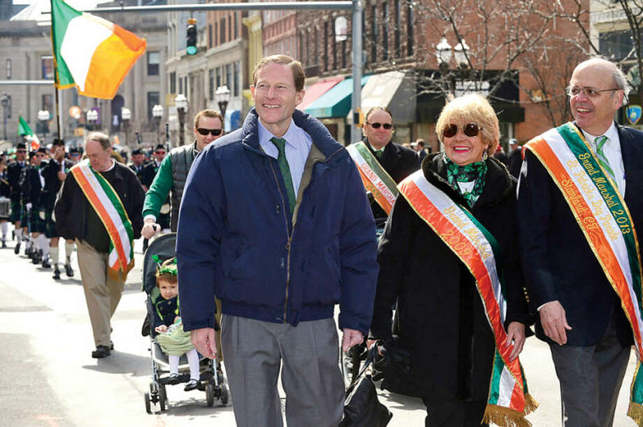 Hour photo / Erik Trautmann US Senator Richard Blumenthal participates in The Stamford St. Patrick's Day Parade as it follows last year's parade route proceeding North on Atlantic Street and continuing onto Bedford Street Saturday.