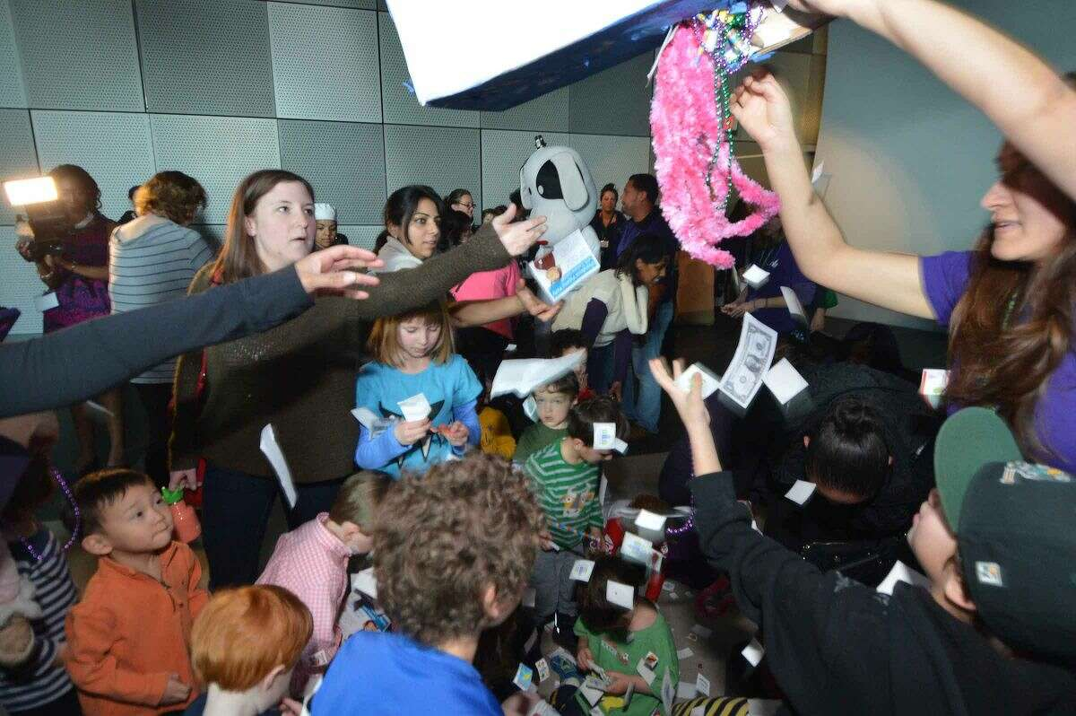 Hour Photo/Alex von Kleydorff A giant Piñata is released and kids grab for goodies during the 15th anniversary party at Stepping Stones Museum for Children