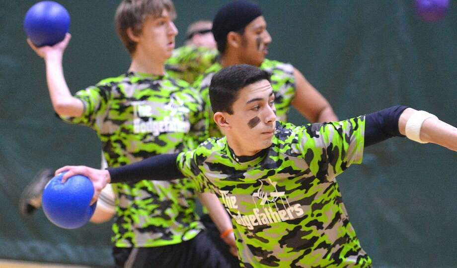 Hour Photo/Alex von Kleydorff Joey Sepuca and the Dodgefathers launch a full team attack during Norwalk High School's sixth annual Charity Dodgeball Tournament to benefit local charities